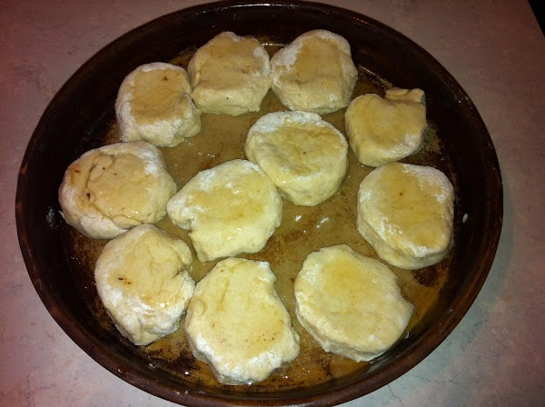 Put your biscuits into the pan and put some bacon grease on top. ...