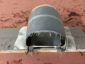 Photo: Roll trim horseshoe curing.