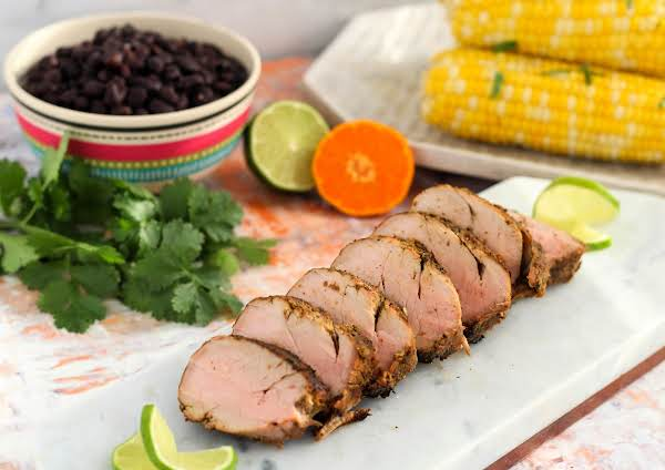Marinated Grilled Pork Tenderloin Sliced And On A Plate.