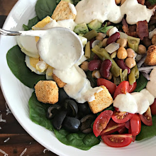 Loaded Spinach Salad with Creamy Roasted Garlic Dressing.