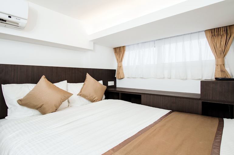 Bedroom at Seah Street Apartments, Orchard Road