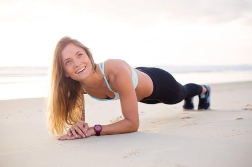 Woman Exercising Bear Body of Water