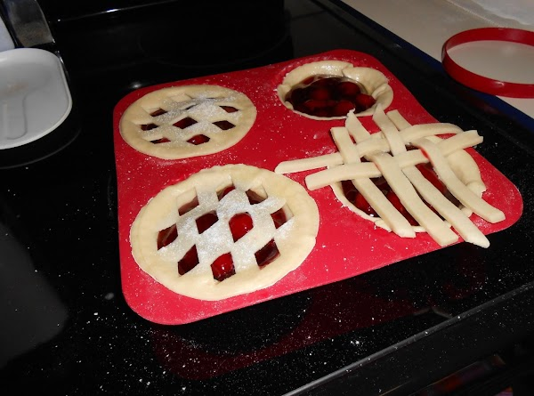 Roll out second pie crust and cut into four four-inch circles. Use the kit's...