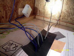 Photo: Center roof pass-thru for cabling in ceiling of loft.  (No pic of the tape sealing of the EPDM gasket.)