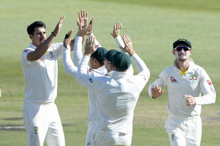 Mitchell Starc of Australia celebrates the wicket of Faf du Plessis of the Proteas with his team mates during day 2 of the 1st Sunfoil Test match between South Africa and Australia at Sahara Stadium Kingsmead on March 02, 2018 in Durban.