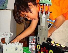 Photo: A boy reaching into a Castle