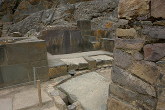 Photo: Bathrooms with water conduit in the natural rock above and outflow in the floor.
