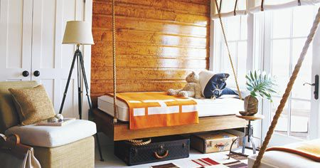 hanging bed in a cabin-style bedroom
