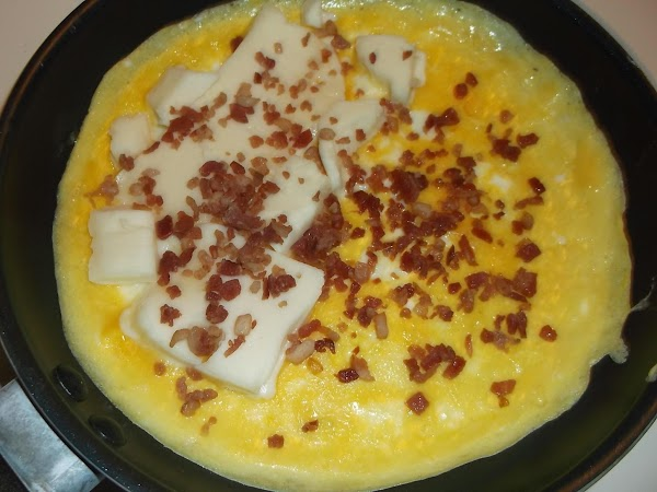 Place cheese slices on egg and sprinkle with 1/2 of the bacon bits.