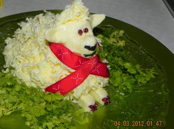 Add your eyes, nose (if you want), ribbon around the neck, flag and parsley...