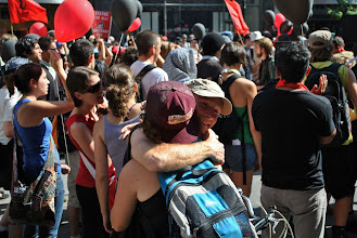 Photo: Two demonstrators embrace amidst a large crowd during the G20 Summit weekend.