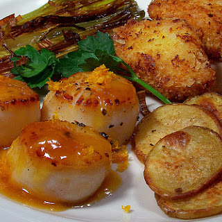 Pan-Seared Scallops with Grand Marnier Reduction Sauce.