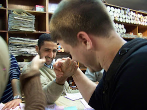 Photo: Arm wrestling at the papyrus store after the perfume shop.