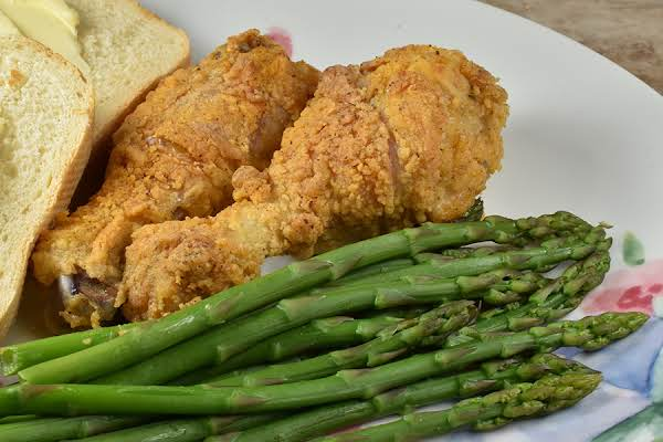 Easy Baked Drumsticks, Asparagus, And French Bread.