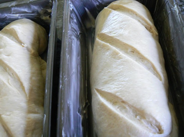 Shape into 2 oblong or round loaves. Place on a greased baking sheet sprinkled with...