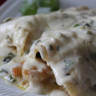 Shrimp and Spinach Enchiladas with Jalapeno Cream Sauce.