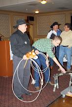 Photo: Tye Halverson, Southwest Sales (sitting on his horse), Ryan Murphy calming the cow down.