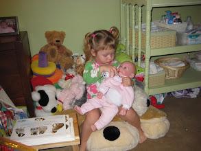 Photo: feeding her baby