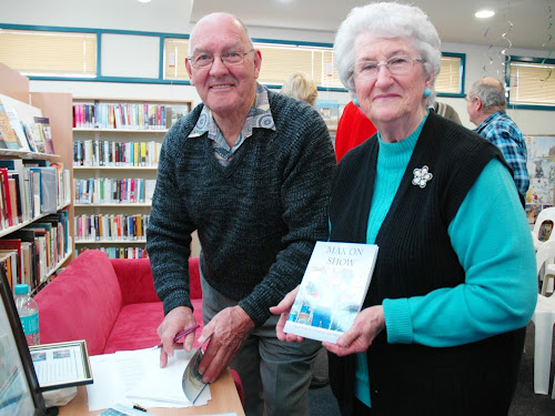 Happy reader: Max Pringle signs a copy of his new book, Max On Show, for Sally Alexander.