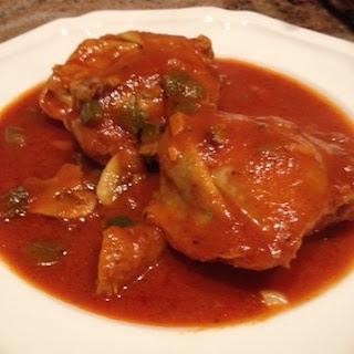 Chicken Thighs In Tomato Sauce.