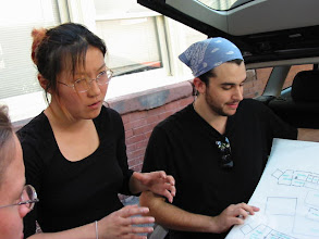 Photo: kitty and joe explaining their work.