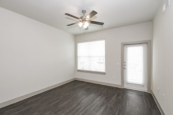 Living room with ceiling fan and wood flooring