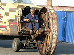 Photo: Andrew pulling an aeroplane on the film set of Exodus (2007)