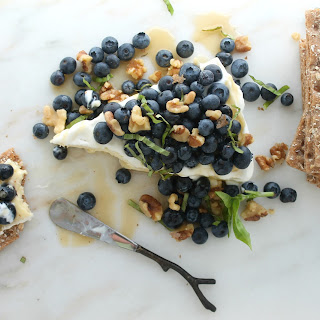 Honey Drizzled Brie with Blueberries, Walnuts and Basil.