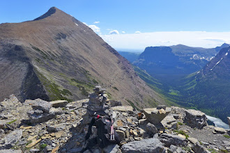 Photo: Summit cairn on Triple Divide Peak, looking into Atlantic Creek drainage - faint view of trail I followed below center of photo (on slope of Mt. James). Notice the nice U-shaped valley (classic glacial trough).