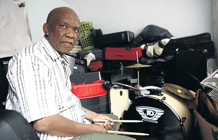Pastore Mahlapahlapana Themane next to his son's drums, which Thorisho used to play before his gruesome murder in Polokwane last week.