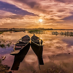 A Pair of Boats at Rest by Manabendra Dey - Landscapes Sunsets & Sunrises ( assam, sunset, india, chatla )