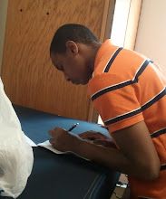 Photo: Miles fills out paperwork