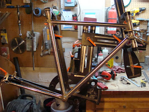 Photo: I've got the lugs all cleaned up and now just one more time in the fixture to check the lug fit.