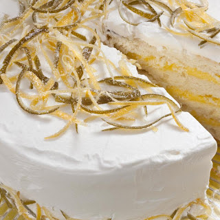 White Cake with Lemon-Lime Curd Filling and Whipped Cream Frosting.