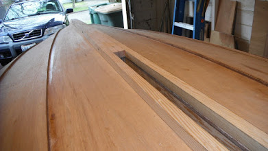 Photo: Looking aft showing the taper of the keel rub strakes.  The screws are to temporarily fasten the rub strakes to the skeg while shaping and fitting.