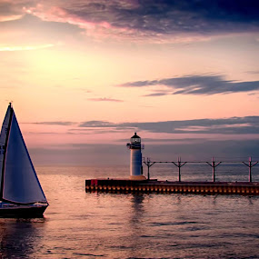 Sunset Sail by Bill Frische - Landscapes Waterscapes ( michigan, st., joseph, set, lighthouse, sail, sun, , Free, Freedom, Inspire, Inspiring, Inspirational, Emotion )