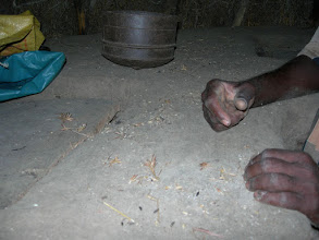 Photo: see the other chambers.One near his right hand and the other opposite to the hands with wooden lid.Note the bushel, to measure !