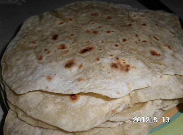 Spray skillet bottom of tortilla with non stick spray, place that side down in...
