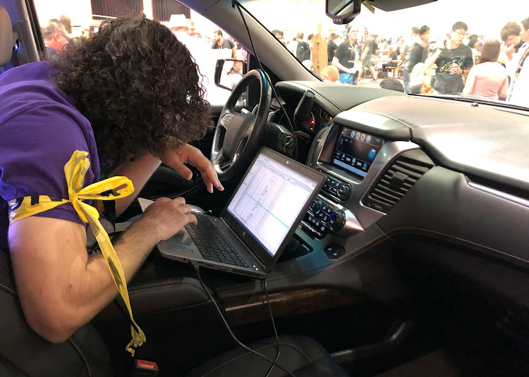 An attendee of last weekend's 2019 Defcon cybersecurity event in Las Vegas is seen at the conference's car-hacking village.