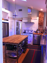 "Photo: The kitchen gets the best light in the whole house and is an amazing space, with a very tall ceiling, two skylights, a vintage O'Keefe and Merritt stove from 1940 (best burners ever), and stainless features throughout. The old chimney was for the original woodstove in the farmhouse kitchen. There's also an entry into this chimney from the dining room, so there used to be a wood-burning stove in there too. Next to the chimney in the kitchen was an old wood-storage closet.  To the left of the doorway is the old ""cooler"", which is now the pantry. The ""cooler"" was a blow-through food storage area with screen below leading to under the house, and screen above, leading into the attic, so that passive cooling would keep food cool.  This is pre-ice-box era!"