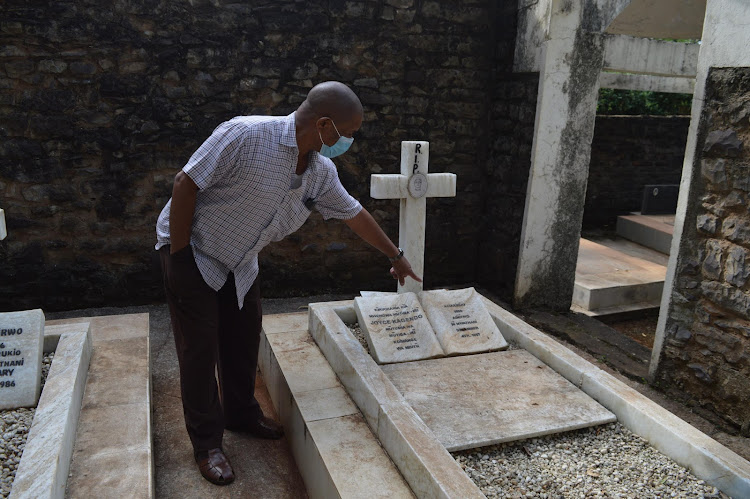 A Koinange family member at the grave site of grandmother to the late Paul Koinange