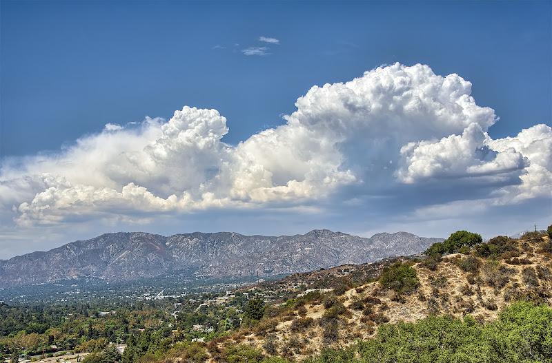 Photo: Some dreams are simply worth waiting for.  A few weeks ago the city of Glendale was treated to some incredibly epic cloud formations. I had made several attempts to shoot them from someplace, but by the time I got high enough they always seemed to be carried off by the wind and clearing the sky. But on this day I was finally able to shoot them from a distance. It was super hot outside but I didn't want to miss another chance to shoot these great clouds somehow, so I packed a bottle of water and headed out finding myself on the top level of the Glendale College parking lot. I would have much rather been up in the mountains right in the heart of this dream, but they were being swept away again so I went for a spot I knew I could get to quick and easy. I hope Mother Nature treats me to clouds like this again soon, but if they'll look like this, I really don't mind waiting.  #MountainMonday