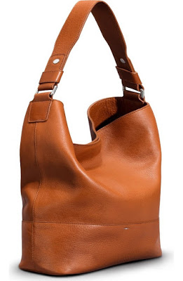 44f0951f33d8 The Shinola relaxed leather bag is a gorgeous casual bag that is made with  finely grained leather in a gorgeous bourbon color