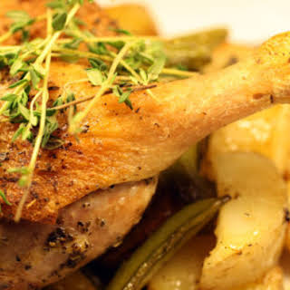 Rustic Roast Duck with New Potatoes, Sugar Snaps, and Spring Onions.