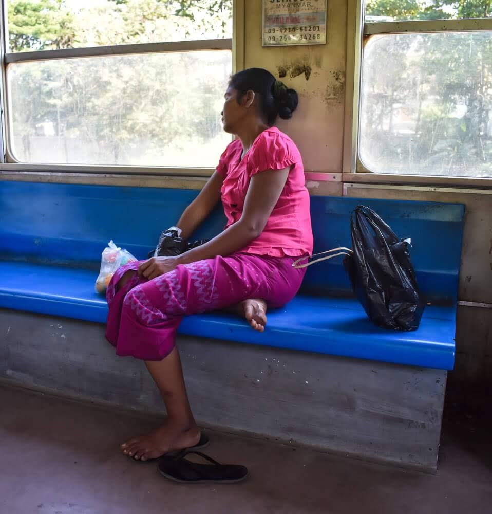 Burmese woman sleeping in circular railway in yangon