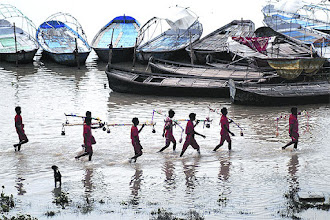 Photo: Kanwariyas return after collecting water from holy River Ganges in Allahabad. (PTI)