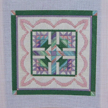 "Photo: Completed 22 Feb 2008. Flower Basket Quilt by Laura Perin from Stitcher's World (date unknown). Stitched on 18 ct white mono canvas using #5 DMC pearl cottons and Caron Collection Watercolours ""Eggplant"". Stitch count: 106w x 106h."