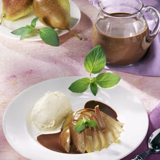 Pears in White Wine with Vanilla Ice Cream and Chocolate Sauce