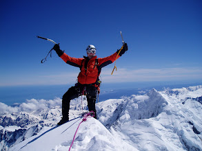 Photo: Made it! Phil celebrates his 60th year on the summit of Mt Cook, with a backdrop of Mt Tasman and the West Coast.