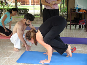Photo: Participant practices asanas as Daniel guides ther through